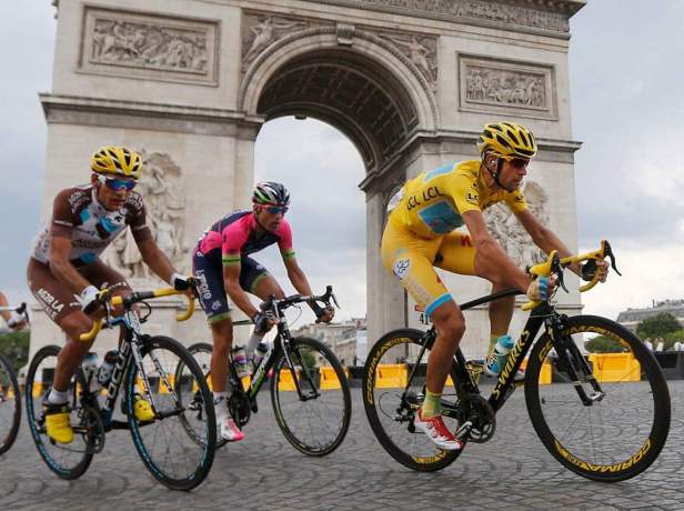 Race leader Astana team rider Nibali of Italy rides near the Arc de Triomphe at the end of the final 21st stage of the Tour de France in Paris