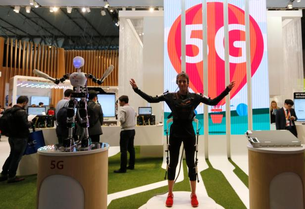 SK telecom exhibitor directs the robot's movements using 5G on the last day at the Mobile World Congress in Barcelona