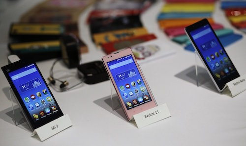 Three models of China's Xiaomi Mi phones are pictured during their launch in New Delhi