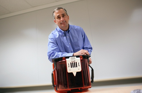 Intel Chief Operating Officer Brian Krzanich poses with a Front Opening Unified Pod, a transport unit for computer chip wafers, with each FOUP containing between 8,000 and 10,000 individual chips, at Intel headquarters in Santa Clara