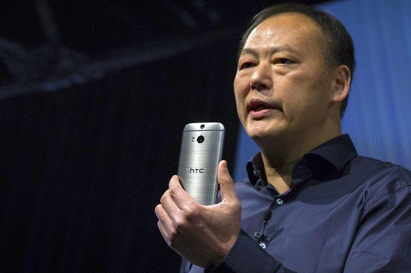 HTC CEO Peter Chou shows the new HTC One M8 phone during a launch event in New York