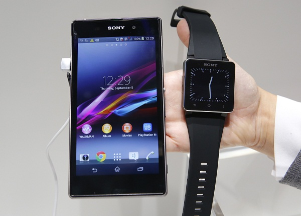 A Sony Xperia Z1 smartphone and a SmartWatch 2 are pictured at the Sony booth during a media preview day at the IFA consumer electronics fair in Berlin