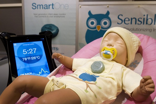 A SmartOne infant sleep monitor is shown on a doll at the Sensible Baby booth during the 2014 International Consumer Electronics Show (CES) in Las Vegas