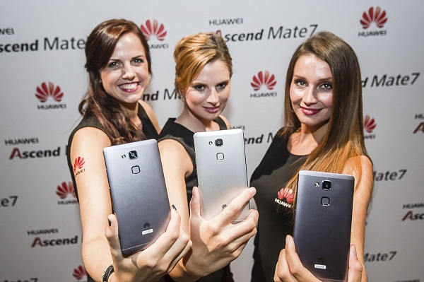 Models hold the Huawei Ascend Mate7 devices during a launch event in Berlin