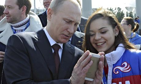 Vladimir Putin looks at a mobile