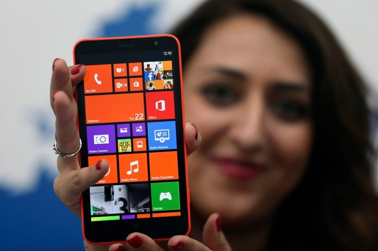 A model displays the Lumia 1320 smartphone during its launch in Abu Dhabi