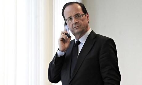 Francois Hollande on his phone